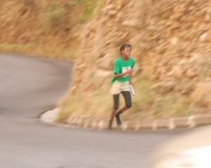 Mikila running the 2nd leg up Fogathy on the 1st S Corner