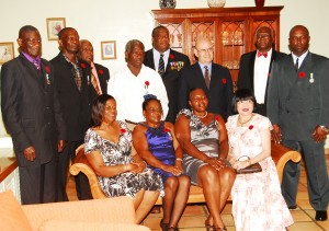 Honoured prison officers with the Governor and his wife