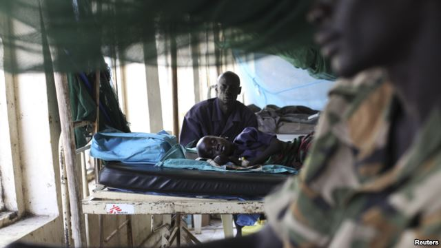 A child sick with malaria and from malnutrition lies on a bed in a hospital in Bor, South Sudan, March 15, 2014.