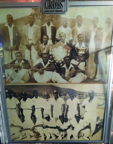 (Top Photo. Montserrat cricket team in Nevis in 1952. Bottom row sitting - Sylvester Davis, Barley Mason, and Thomas Davis - with bat in hand. Bottom photo - Far bottom right Thomas Davis . Other players in that photo are: - standing from left - Sylvester Davis, Don Edwards, Syers, George Edwards, Robert Semper, Son Harris, and Theodore Bramble- Standing. George Edwards has the white scarf on his neck. He is fourth from the left at the top.).*
