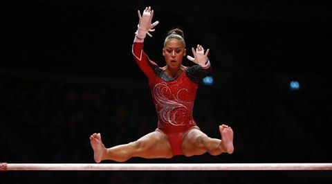 Marisa Dick from Trinidad and Tobago scores 12.533 on her floor routine and 13.66 on the balance beam.