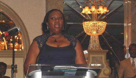 Charge d'Affairs at the embassy of Jamaica, Marsha Coore Lobban, delivers Prime Minister Andrew Holness's message at the Jamaican Association of Maryland Gala in celebration of Jamaica's 54th year of independence in Baltimore on Saturday August 6, 2016. Photo: Derrick Scott