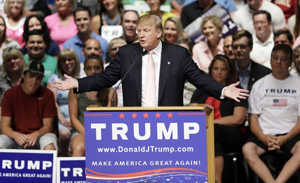 Republican presidential candidate Donald Trump speaks at a rally and picnic, Saturday, July 25, 2015, in Oskaloosa, Iowa. (AP Photo/Charlie Neibergall)