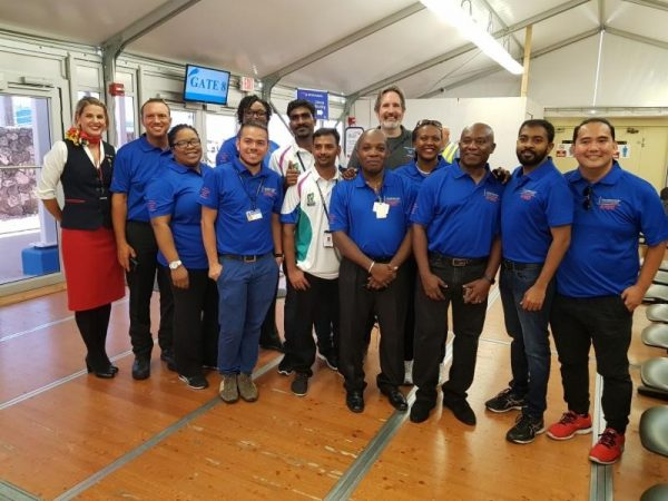 The medical team prepares to board the Cayman Airways flight to Anguilla, which was chartered for the humanitarian mission. Two nurses from Health City Cayman Islands joined the group of medical professionals from the Cayman Islands Health Services Authority on the relief effort.