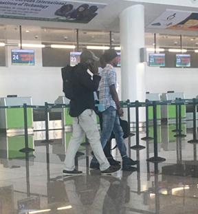 Jermaine Gordon under escort at VC Bird Int. airport