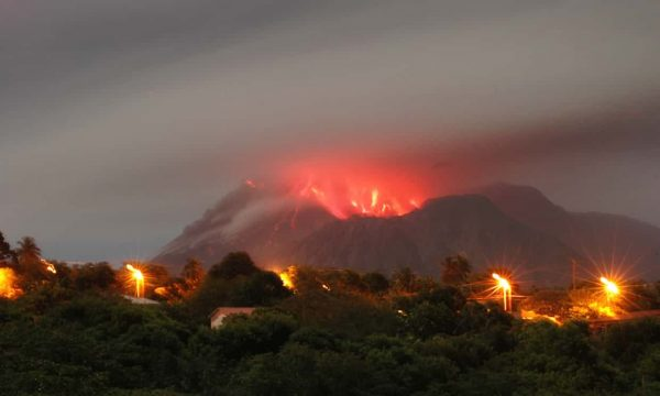 Ash and lava are visible inside the cone of the Soufrière Hills volcano, seen from Olveston, Montserrat, in January 2007. Photograph: Wayne Fenton/AP