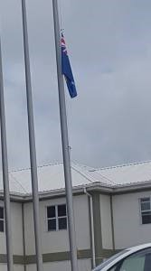 Police HQ flag at half mast in remembrance of former Chief Minister Bertrand Osborne.