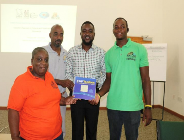 Representatives of the Fisheries and Ocean Resources Unit in Montserrat receive a copy of the EAF toolkit